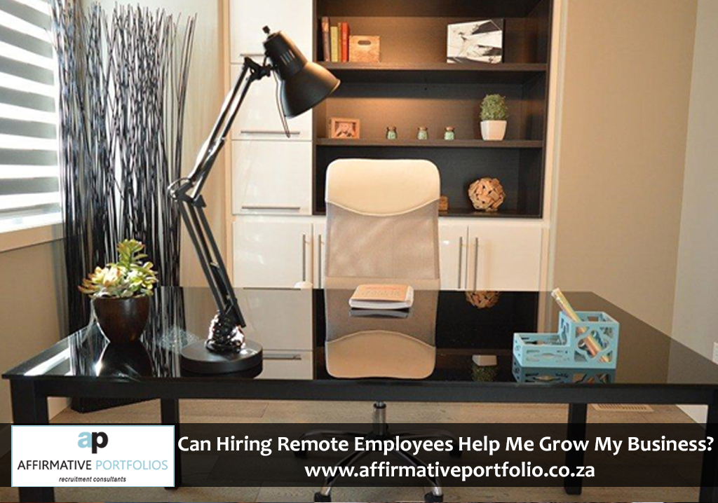 : Stylish and neat home office with a desk lamp on, ready to work.